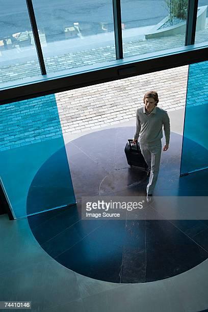 Man walking into hotel