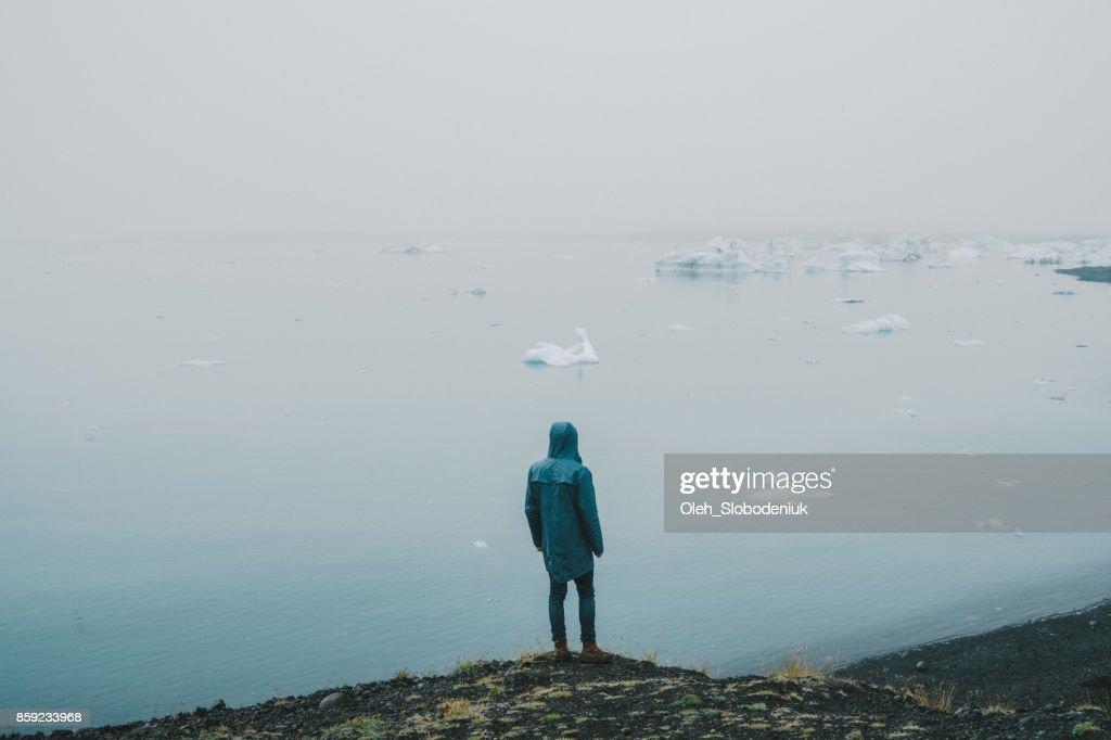 Man  walking near Jokulsarlon lagoon : Stock Photo