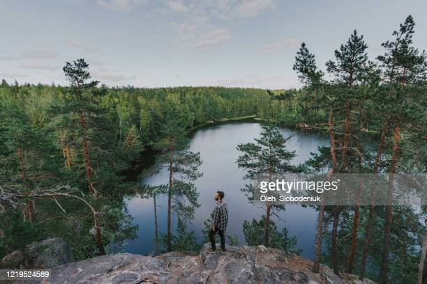 man walking near the lake in summer - finland stock pictures, royalty-free photos & images