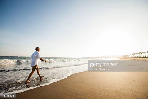 A man walking on a beach.