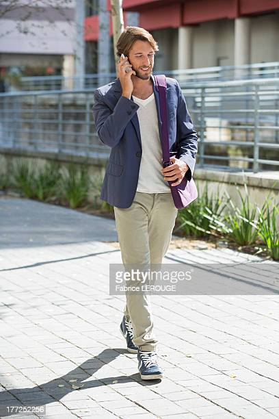 Man walking on a street and talking on a mobile phone