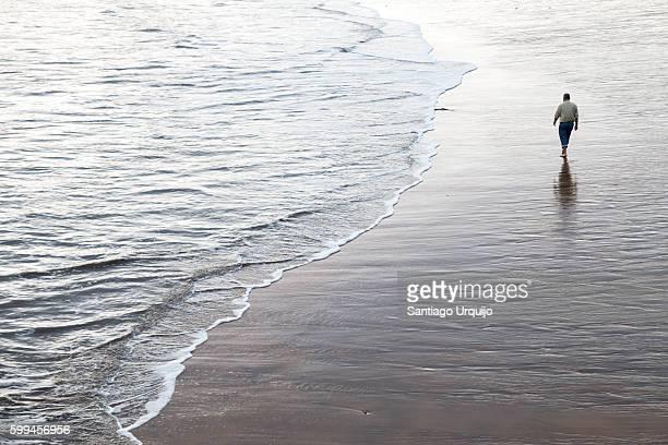 Man walking on an empty beach