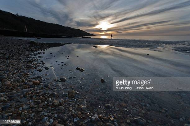 man walking on beach - s0ulsurfing stock pictures, royalty-free photos & images