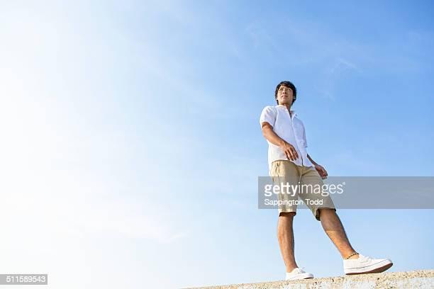 Man Walking On Breakwater