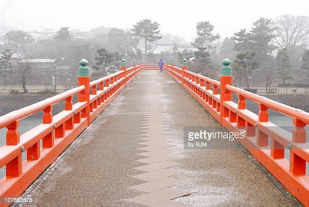 man walking on bridge in uji - uji kyoto stock pictures, royalty-free photos & images