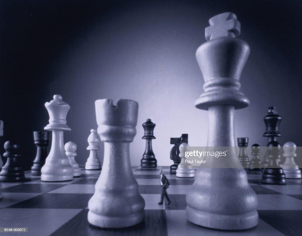 Man Walking on Chess Board : Stock Photo