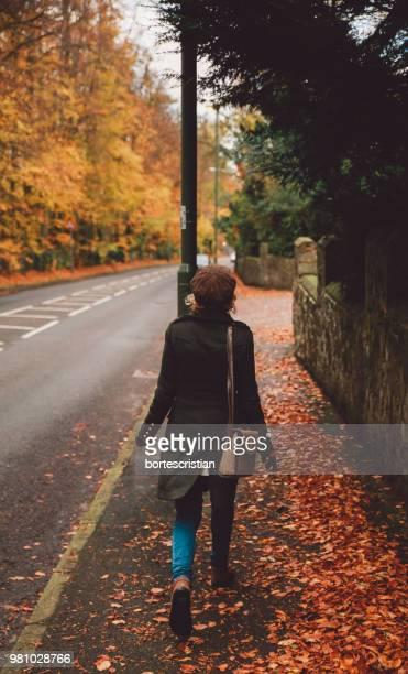 Man Walking On Road During Autumn