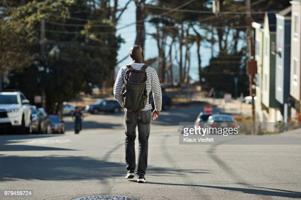 Man walking on steep road in San Francisco