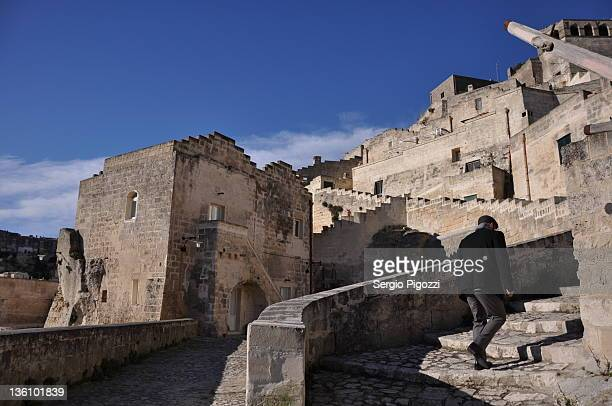 man walking on streets of matera - matera stock photos and pictures