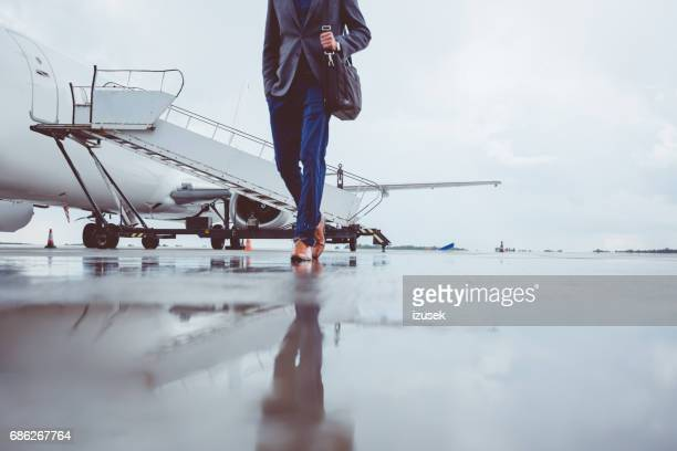 Man walking on tarmac at the airport