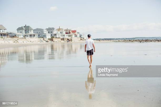 man walking on the beach, maine beach, usa - new england usa stock pictures, royalty-free photos & images