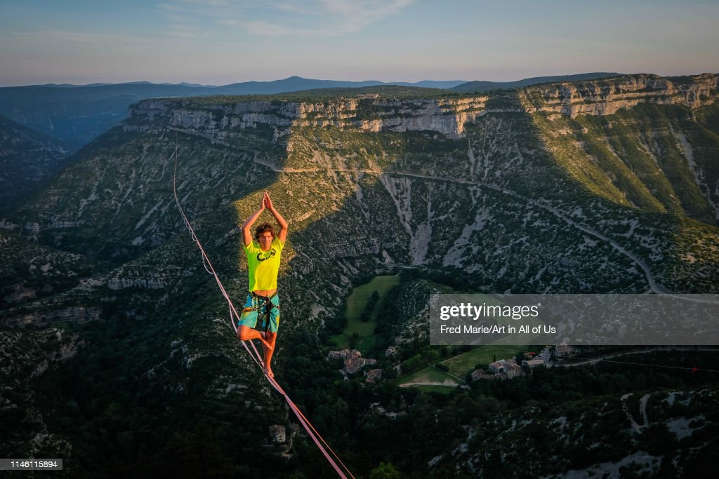 A man walking on the longest slackline ever in navacelles circus (world humanity patrimony) at 300 meters high, Occitanie, Navacelles, France... : News Photo