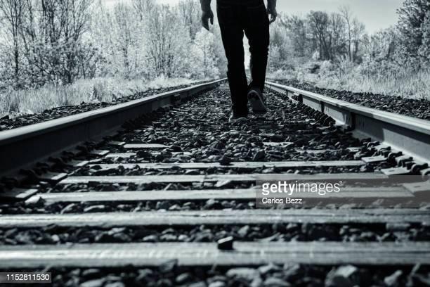 man walking on the railway tracks - suicídio imagens e fotografias de stock