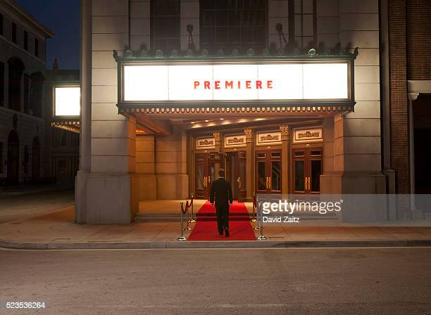 man walking on the red carpet - building entrance stock pictures, royalty-free photos & images
