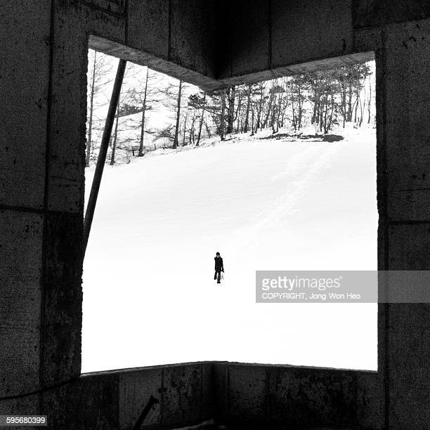 A man walking on the snowfield