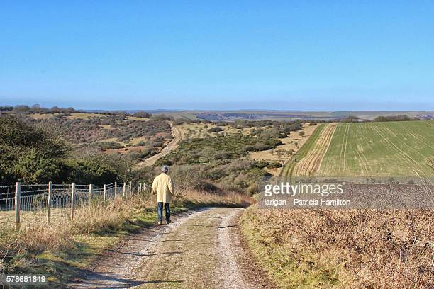 Man walking on the South Downs, East Sussex
