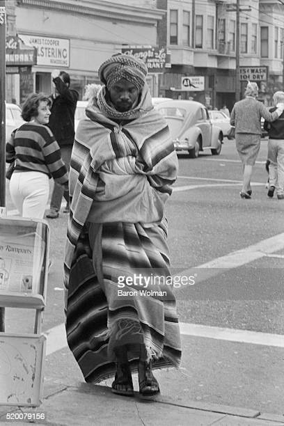 Man walking on the streets of HaightAshbury San Francisco CA March 26 1967
