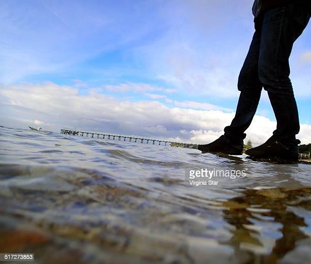 man walking on the water - ブーツイン ストックフォトと画像