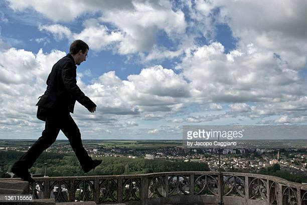 man walking on top - jacopo caggiano stock pictures, royalty-free photos & images