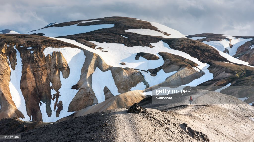 A man walking on volcanic landscape Landmannalaugar Mountain : Stock Photo