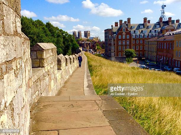 man walking on york city walls - york stock photos and pictures