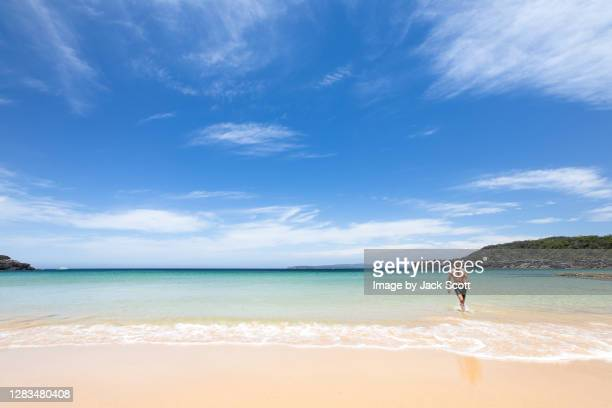 man walking out of ocean - leaving stock pictures, royalty-free photos & images