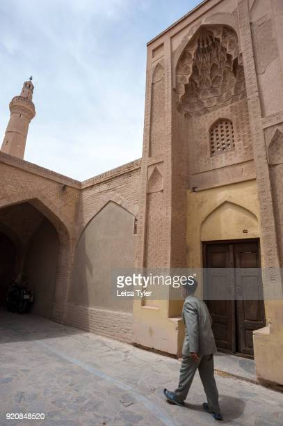 A man walking outside the Nain Grand Mosque or 'Masjede Jame' Nain' in Persian is a congregation mosque and one of Iran's oldest It originally dates...