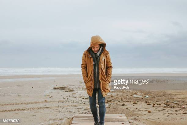 man walking storm - winter coat stock pictures, royalty-free photos & images