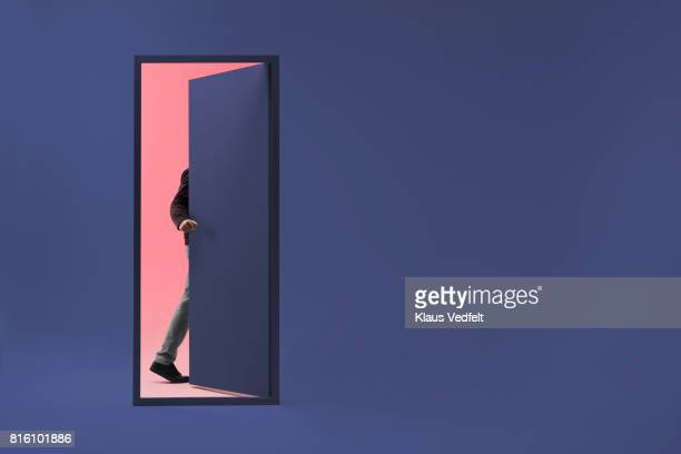 man walking threw doorway in futuristic room - porta imagens e fotografias de stock