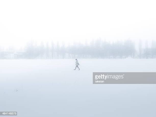 Man walking through a snowfield