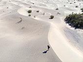 solo man walking through dry hot