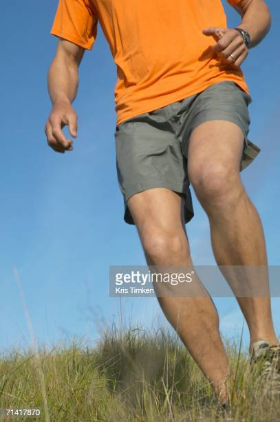 Man walking through grass
