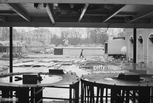 A man walking through the remains of the Battersea Park Funfair at Battersea Park in London UK 18th February 1975