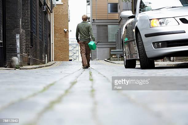 Man Walking to Get Gas