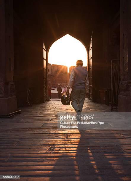 Man walking toward archway, Agra Fort, Agra, Uttar Pradesh, India