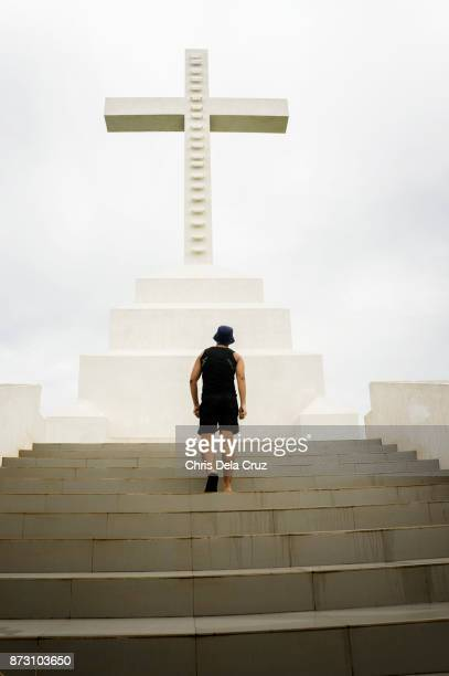Man walking towards a cross