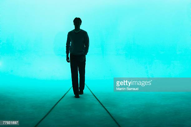 man walking towards camera - back lit stock pictures, royalty-free photos & images