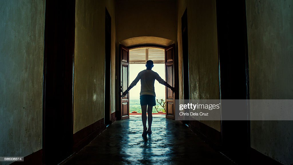Man walking towards the door in cape bojeador lighthouse : Stock Photo