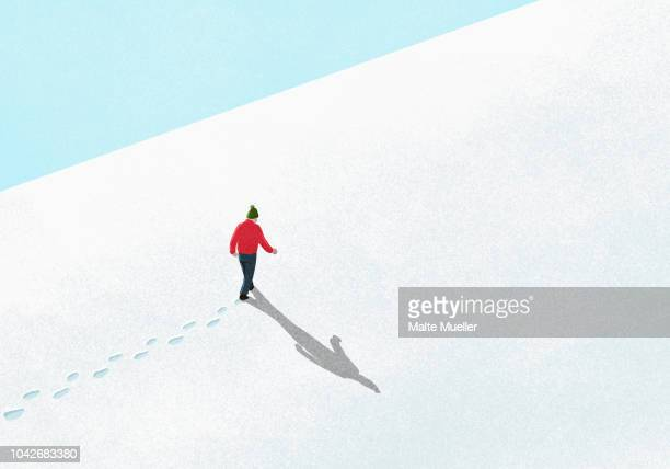 man walking up snowy slope - illustration stock pictures, royalty-free photos & images