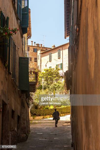 A man walking up stairs in Montepulciano