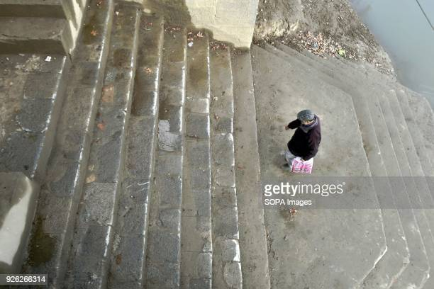 A man walking up stairs on a partly cloudy day in Srinagar Indian administered Kashmir Ahead of prediction of rain and snow from Thursday due to a...