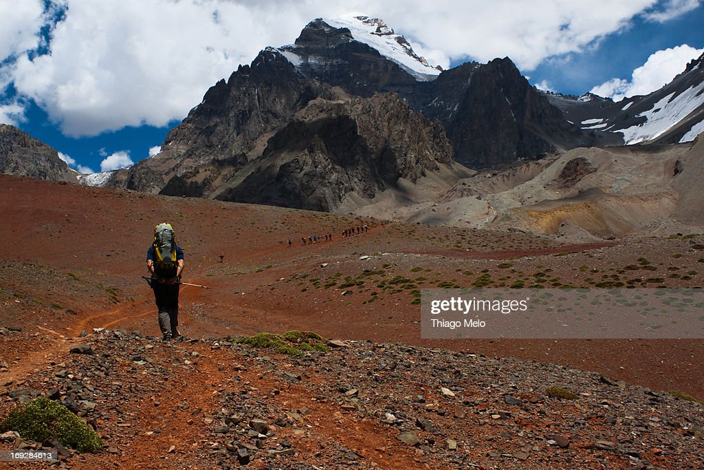 Man walking with Aconcágua mount in the background : Stock Photo