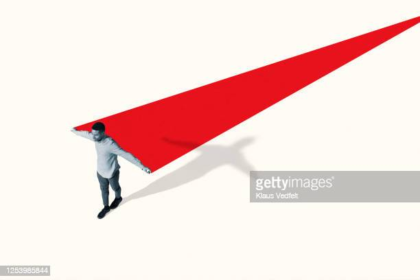 man walking with arms outstretched by red ramp - chance stock pictures, royalty-free photos & images