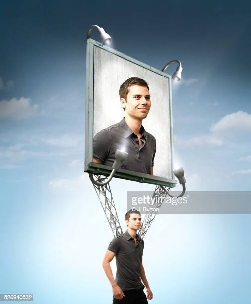 man walking with billboard of himself strapped to his shoulders - vanity stock pictures, royalty-free photos & images