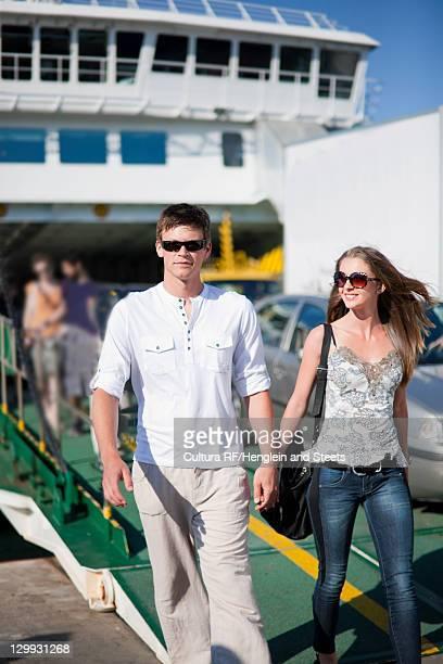 Man walking with girlfriend on ferry