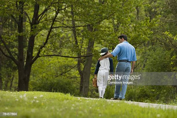 man walking with little league player - pep talk stock pictures, royalty-free photos & images