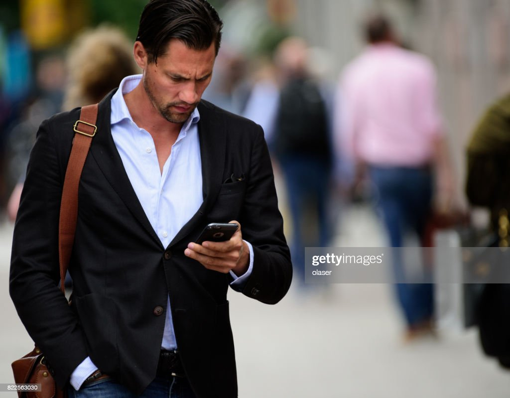 Man walking with phone : Stock Photo