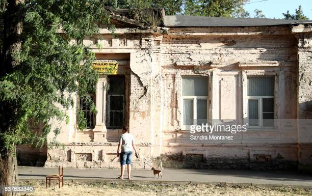 A man walks a dog at RostovonDon city during a media tour of Russia 2018 FIFA World Cup venues on August 19 2017 in RostovonDon Russia
