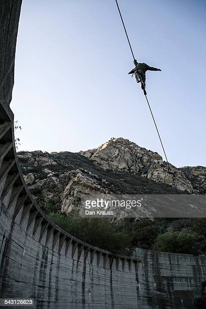 Man walks a highline between the Ringe Dam in Malibu, Calif.