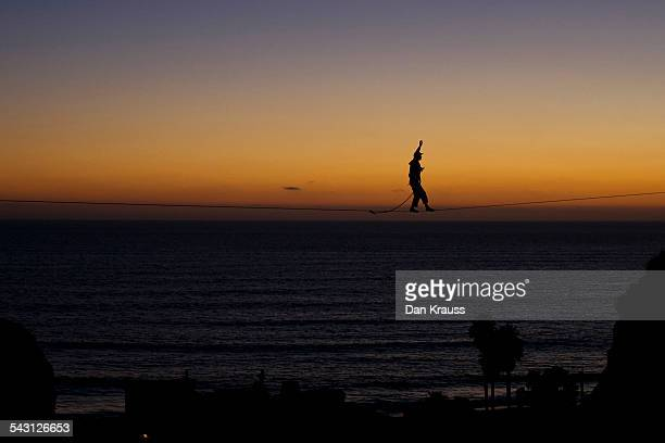 Man walks a highline over the Pacific Ocean in San Clemente, Calif.